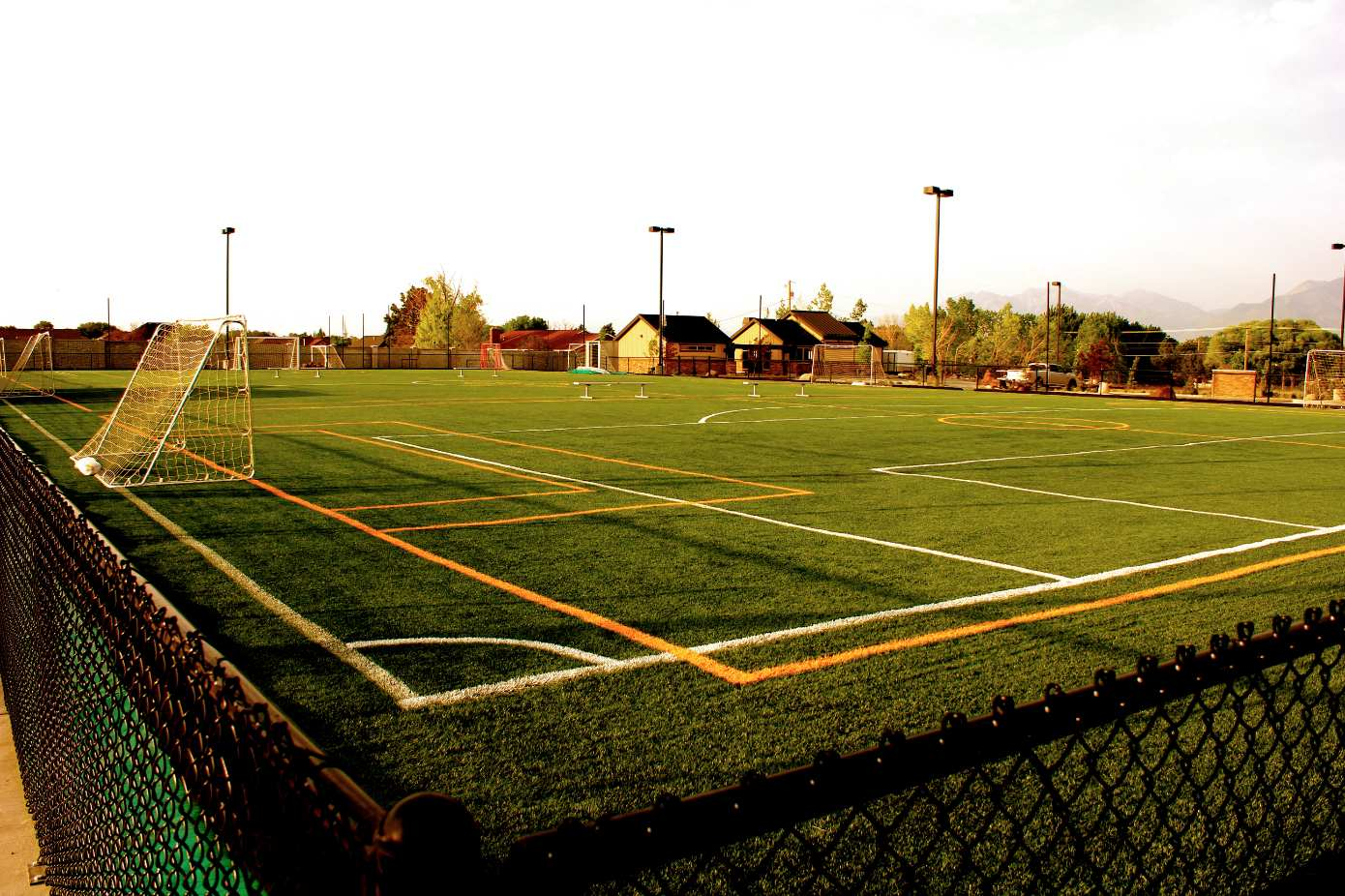 Large turf field (6 stations/3 small fields/1 large field) during sunset.